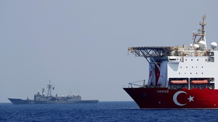 FILE PHOTO: Turkish drilling vessel Yavuz is escorted by Turkish Navy frigate TCG Gemlik (F-492) in the eastern Mediterranean Sea off Cyprus, August 6, 2019. REUTERS/Murad Sezer