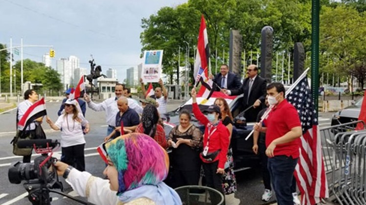A group of members of the Egyptian community in New York and New Jersey gathered outside the United Nations headquarters in New York City on Saturday to celebrate the seventh anniversary of the June 30 revolution.