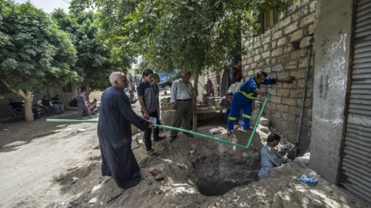 File Photo: Egyptian men install water pipes in the village of al-Jendaya, in the Bani Mazar province, in the Minya governorate some 200km south of Cairo (AFP)