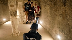 A security guard takes a photograph of tourists inside the standing step pyramid of Saqqara after its renovation, south of Cairo, Egypt March 5, 2020. REUTERS/Mohamed Abd El Ghany