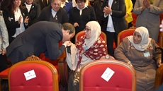 President Abdel Fatah al-Sisi kisses hand of an ideal mother on the Egyptian Woman Day-Press photo